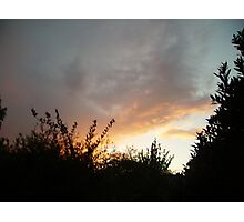 Sunset with red clouds and silhouettes Photographic Print