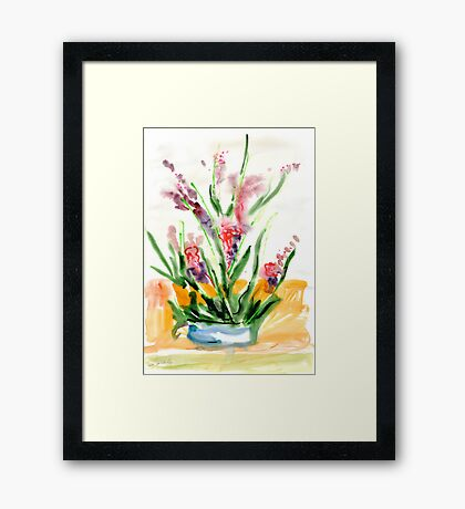 Red flowers in blue pot Framed Print