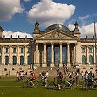 Bicyclists In Front Of Reichstag, Berlin, Germany by Dmitry Shytsko