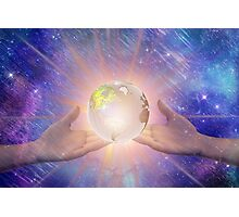 Hands with a Glowing Earth Photographic Print