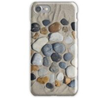 Beach stones in the sand iPhone Case/Skin