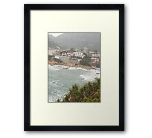 expensive homes on secluded rocky cliff Framed Print