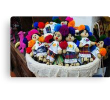 Basket of dolls Canvas Print