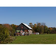 Roadside Gems - Sign Covered Wooden Barn Photographic Print