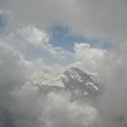 A Peek Through the Clouds - Mt. Shilthorn, CH by Danielle Ducrest