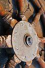 Ship's wheel close-up by Leon Heyns