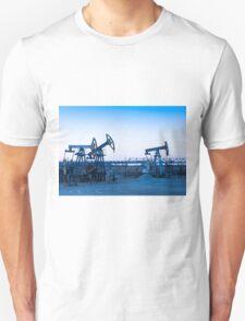 Oil pumps on a oil field. Unisex T-Shirt