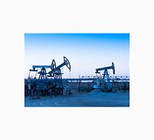 Oil pumps on a oil field. Unisex T-Shirt