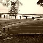 Old boat and Jetty -Tamar Valley    sepia by lighthousecove