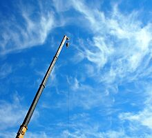 Boom of the crane on a diagonal against a blue sky  by vladromensky