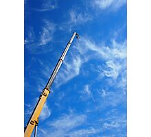 The boom of the crane on a diagonal against a blue sky  Photographic Print