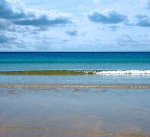 gentle blue waves lashing onto ballybunion beach by morrbyte
