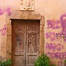 An old wooden door by Michele Filoscia