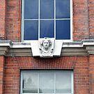 Sculptured Key Stone At Kensington Palace, London by James J. Ravenel, III