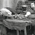 asleep in the market by Andy James