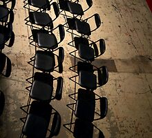 Rows of black chairs. by cloud7