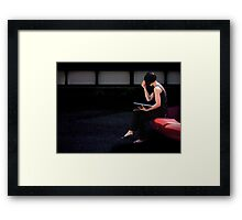 girl on a red seat Framed Print