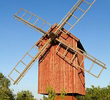Old wooden windmill. by cloud7