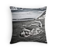 tree trunks on beach Throw Pillow