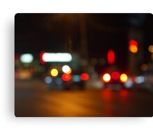 Defocused red and yellow lights on the night the traffic Canvas Print