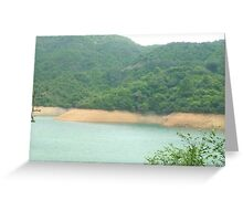 crystal clear lagoon on side of lush green troplical mountain Greeting Card