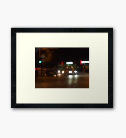 Blur and defocused lights from the headlights Framed Print