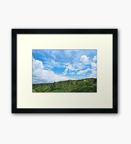 over the mountain, down the sky Framed Print