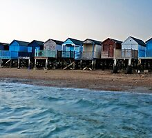 Beach Huts on the shoreline. Southend, Essex, UK  by Andrew Briffett
