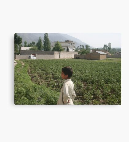 Pakistan- An Afghan boy  view the house of former al-Qaida leader Osama bin Laden Canvas Print