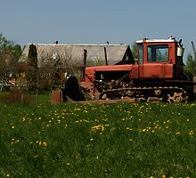 Spring in old farmstead (rural tractor) by Antanas