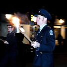 Marching with flaming torch by MarshEvents