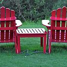 Red Chairs by the sea by waxyfrog