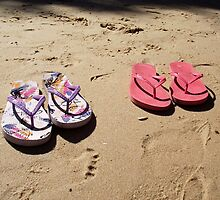 Thongs on a beach by Adelheid