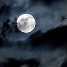 full moon in a cloudy sky by piwaki
