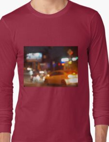Blur and defocused silhouette of the car and traffic lights Long Sleeve T-Shirt