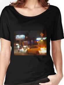 Blur and defocused silhouette of the car and traffic lights Women's Relaxed Fit T-Shirt