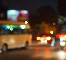 Abstract night scene with bus and headlights by vladromensky
