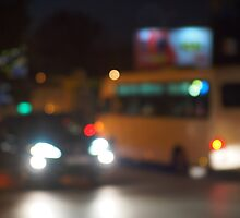Abstract night scene with bus and headlight by vladromensky