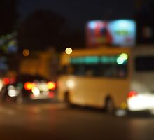 Abstract and blur night scene with bus and headlights by vladromensky