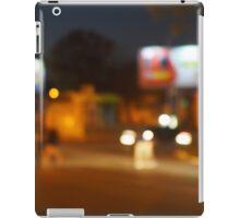 Abstract urban night scene with blurred headlights on the road iPad Case/Skin