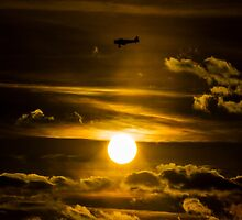 North American Harvard passing the sun by captureasecond