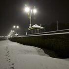 snow falling on the sea wall at night  by benedictwells