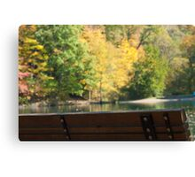 Park bench in the Fall Canvas Print