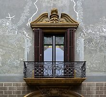 Balcony window surrounded by art by Arie Koene