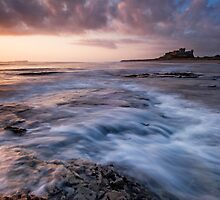 First Light on Bamburgh Castle by Michael Treloar