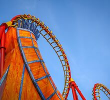 Rollercoaster in an amusement park by patrascano