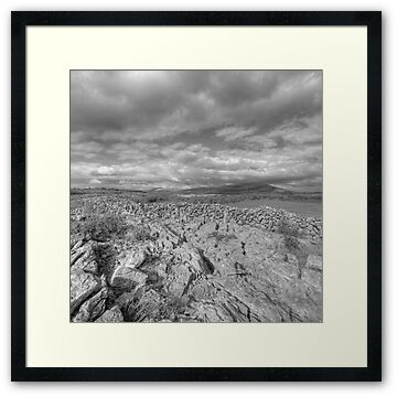Black and white evening view of Mullaghmore mountain in The Burren; county Clare. Knockanes peak is in the background