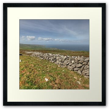 Stone walls in The Burren near Slieve Elva looking towards Fanore Village and The Aran Islands