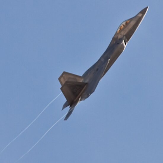 F-22 Raptor banking hard right on take off, creating vapor trails during Red Flag 10-2 at Nellis Air Force Base