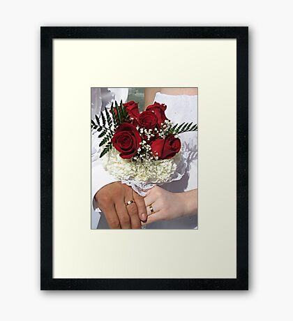 Red roses and wedding rings Framed Print